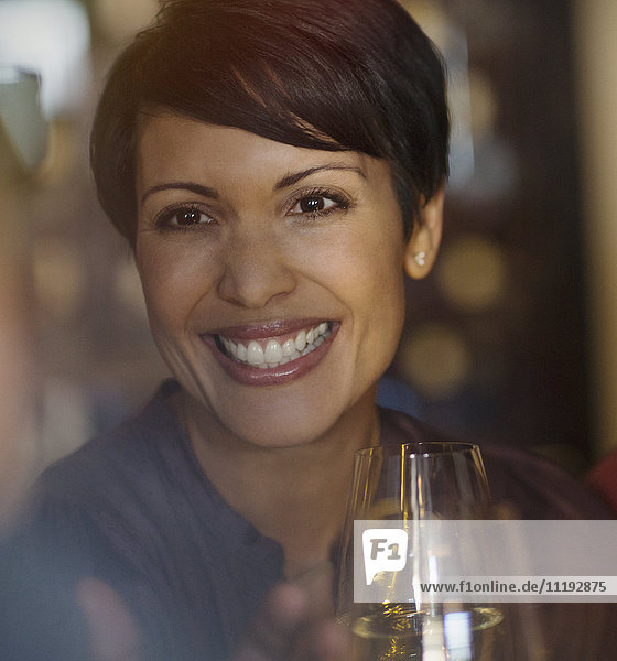 Close up portrait smiling brunette woman drinking white wine