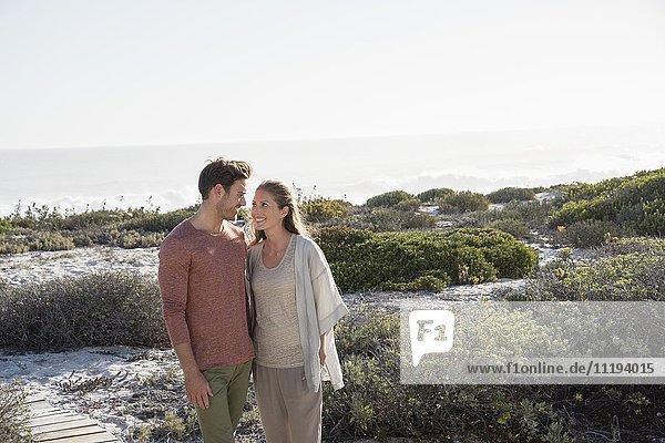 Happy couple enjoying on the beach