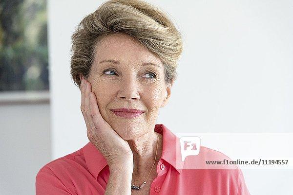Close-up of a happy senior woman thinking