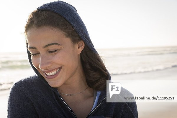 Close-up of a young beautiful woman smiling