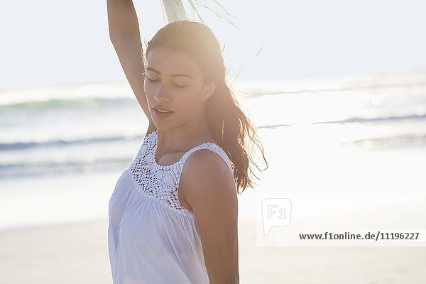 Beautiful young woman posing on the beach
