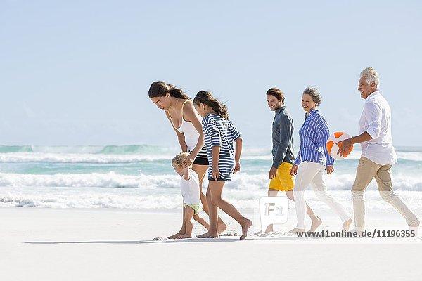 Multi-generation family enjoying on the beach