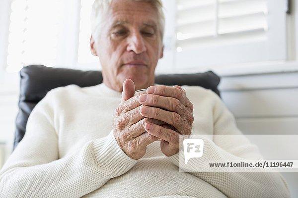 Senior man holding a cup of tea