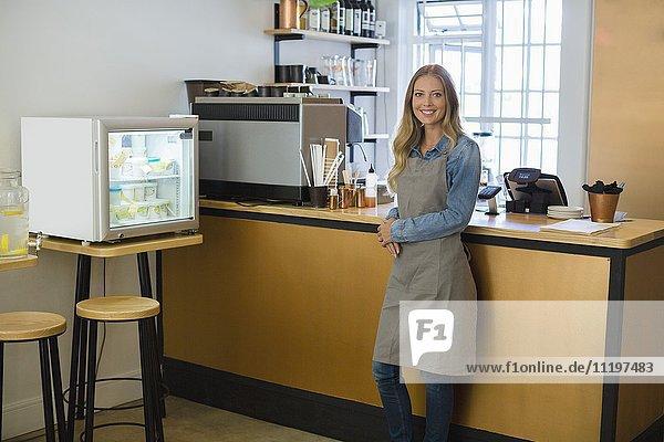 Happy waitress standing in a restaurant
