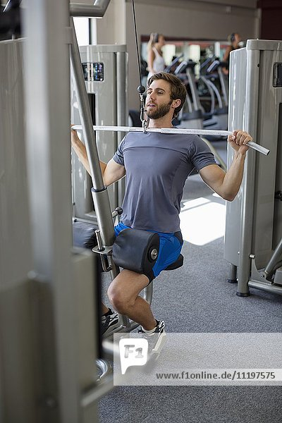 Young man exercising in a gym