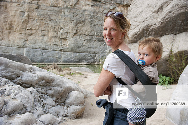 Woman hiking with young son at Big Bend National Park  Texas  USA