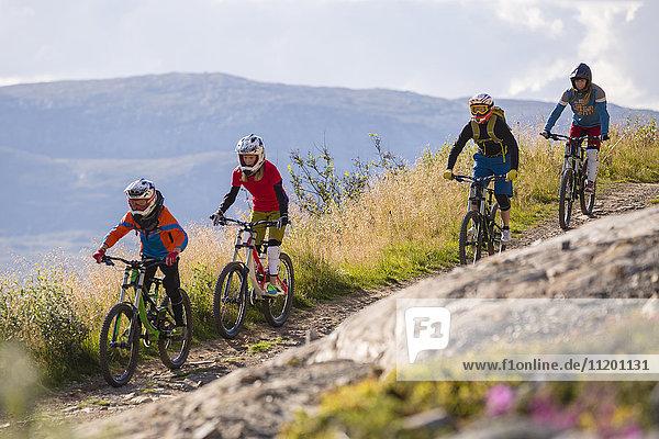 People mountain biking