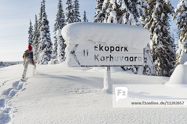 Sign covered by snow