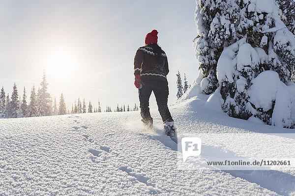 Woman running at winter