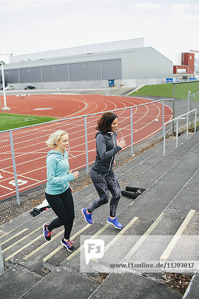 Women running on stadium