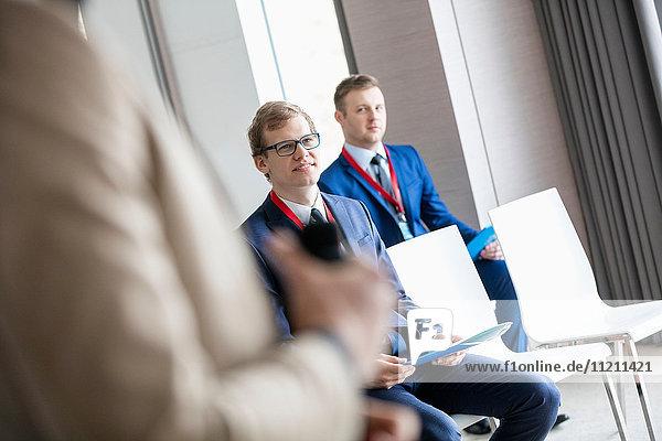 Businessmen and public speaker in seminar hall
