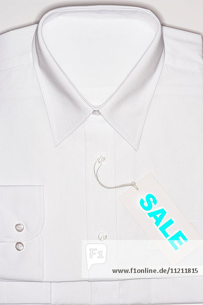 White Shirt with blue sale sign