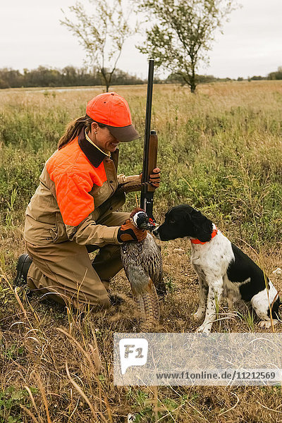 Woman And Springer Spaniel Upland Bird Hunting
