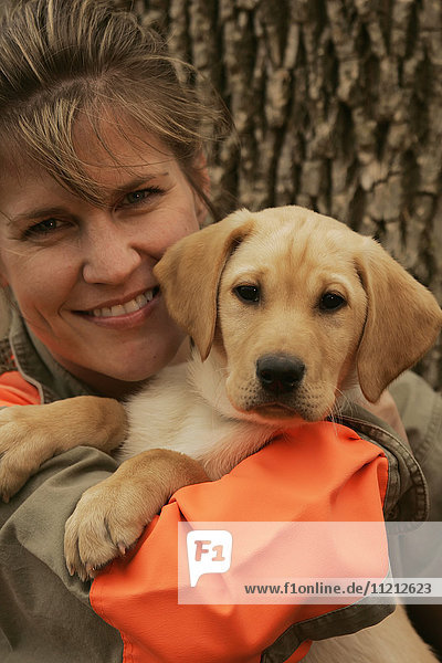 Female Upland Bird Hunter With Yellow Lab Puppy