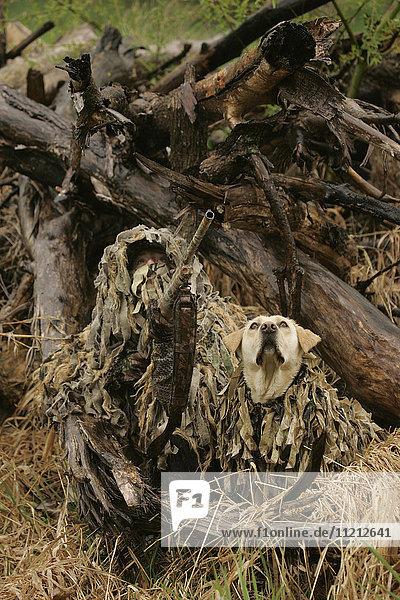 Female Waterfowl Hunter In Rain With Dog