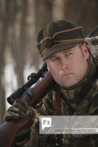 Hunter In Camo With Scoped Rifle