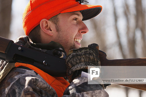 Winter Pheasant Hunter With Shotgun On Shoulder