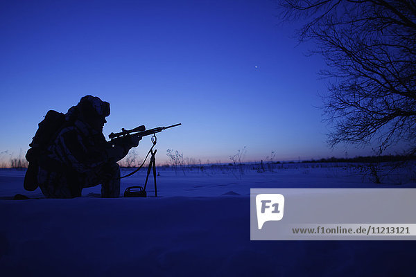 Silhouette Of Cold Weather Varmint Hunter