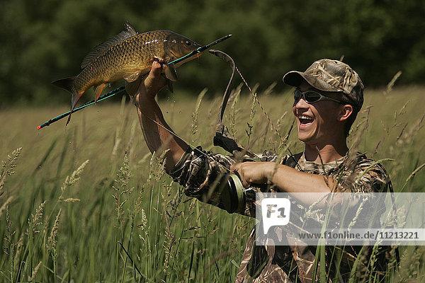 Man Bowfishing Carp