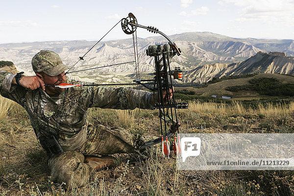 Elk Hunter Drawing Bow