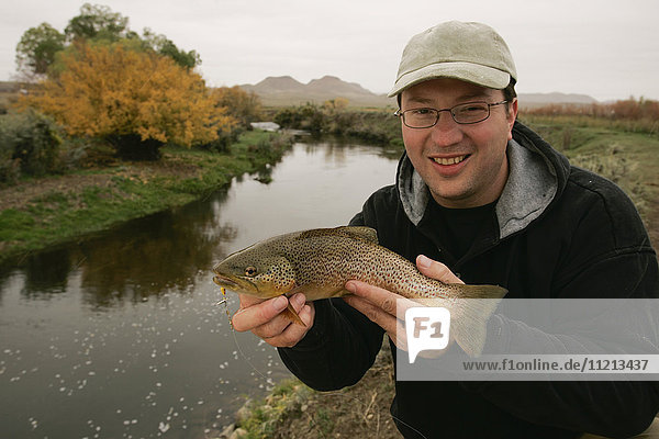 Fisherman With Brown Trout