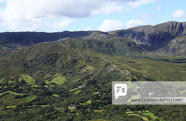 'Rugged green landscape with mountains  near Glengarriff; County Cork  Ireland'
