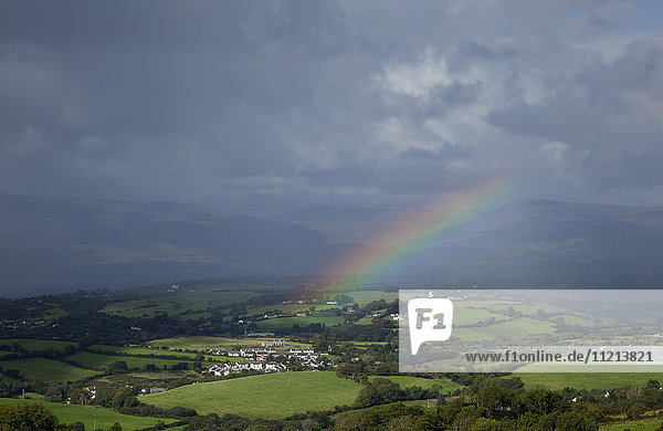 'A rainbow over lush fields under the storm clouds  near Bantry; County Cork  Ireland '