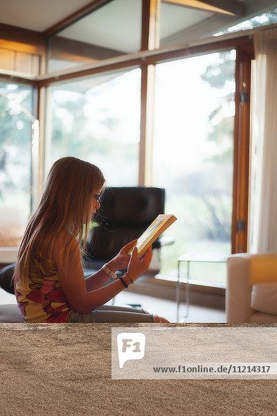 'A young girl reading in her home; Regina  Saskatoon  Saskatchewan'