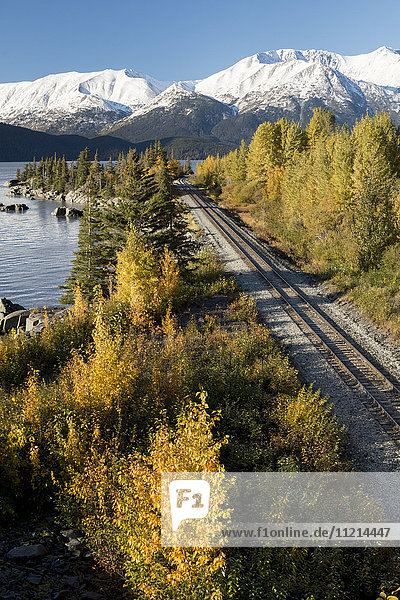 'Landscape  Bird Point  viewed from Seward Highway in autumn  Turnagain Arm and Kenai Mountains in background  tracks of the Alaska railroad in the foreground; Alaska  United States of America'