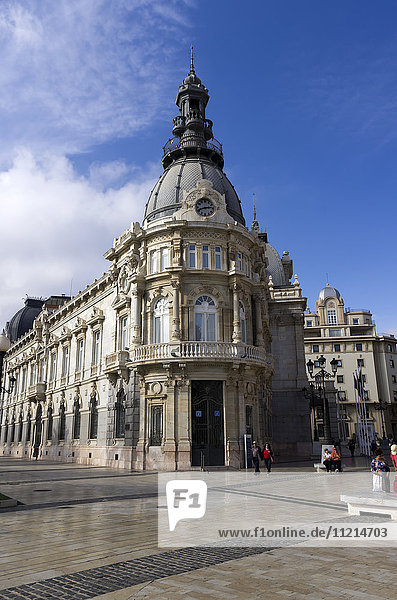 'City Hall Rathaus  several tourists linger near the ornate architecture; Cartagena  Murica  Spain'
