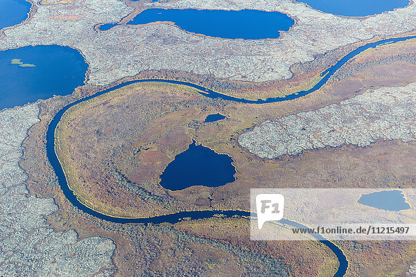 'Aerial view of a stream that runs through a tundra landscape filled with small ponds  Yukon Delta  Arctic Alaska; Saint Mary's  Alaska  United States of America'