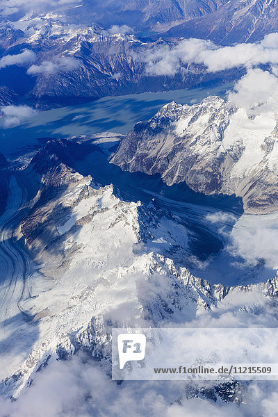 'Aerial view of the Tordrillo Mountains  and glaciers running between them  Alaska Range  South-central Alaska; Alaska  United States of America'