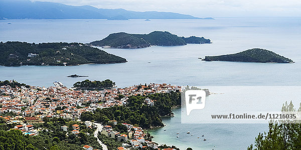'View of the Aegean Sea and a village on the coast of a greek island; Skiathos  Greece'