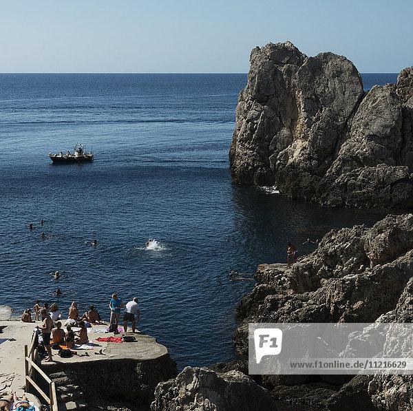 Swimming and sunbathing along the rugged coast of the island of Capri; Capri  Campania  Italy