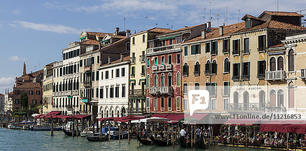 Busy waterfront along a canal; Venice  Italy