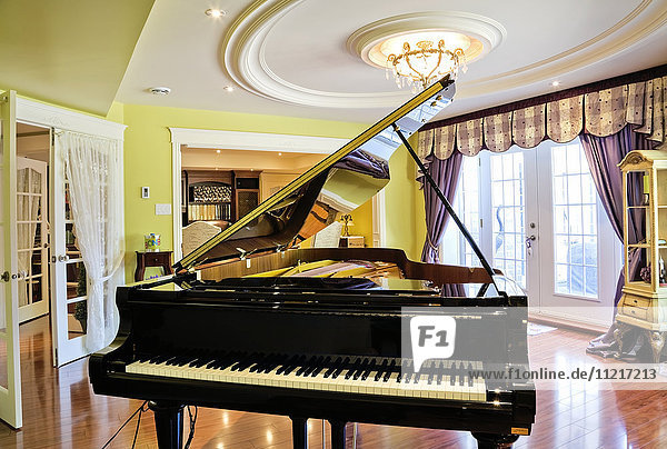 Shigeru Kawai piano in basement music room inside an elegant cottage style home; Quebec  Canada