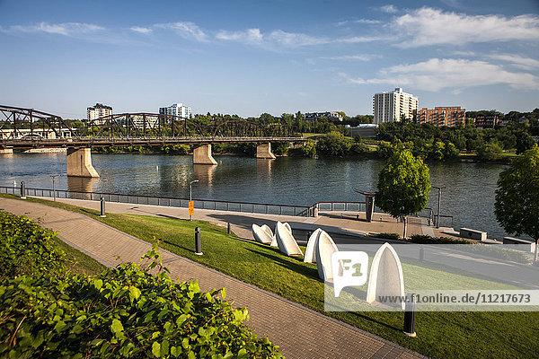'South Saskatchewan River with bridge and promenade; Saskatoon  Saskatchewan  Canada'