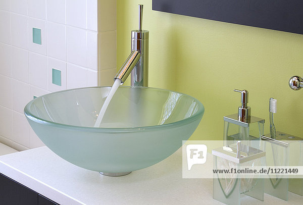 Faucet with running water in contemporary bowl sink