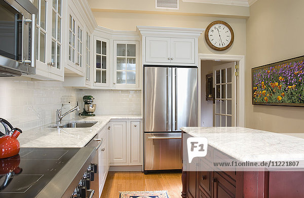 Traditional kitchen with marble countertops