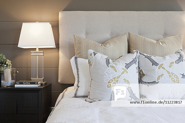 Pillows arrange on bed in contemporary bedroom