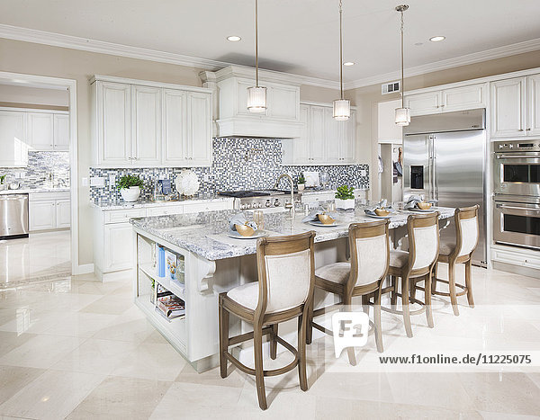 High stools at the kitchen island at home
