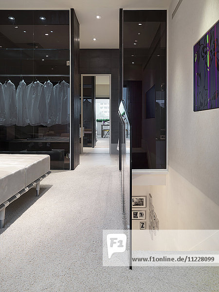 Carpeted hallway and top of staircase in modern home