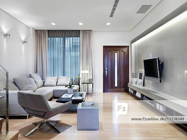 Living room with flatscreen tv in modern home