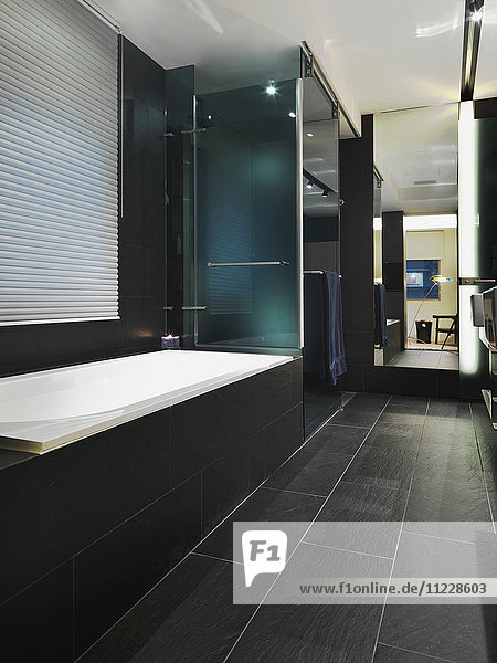 Detail of black tile in modern bathroom