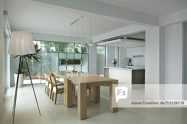 Wooden dining table in modern interior
