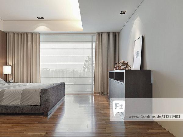 Hardwood floor in modern bedroom
