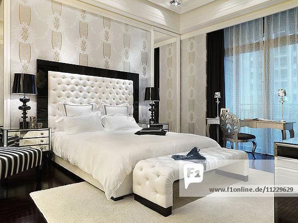 White bed in elegant master bedroom