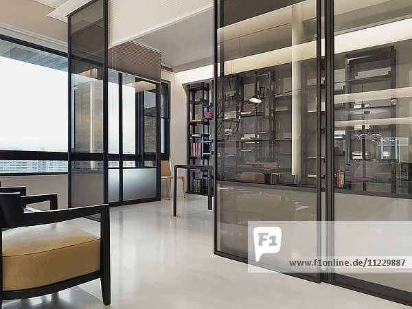 Pocket doors separating living from office in modern home