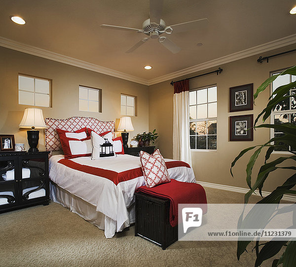 Contemporary bedroom with red and white accents