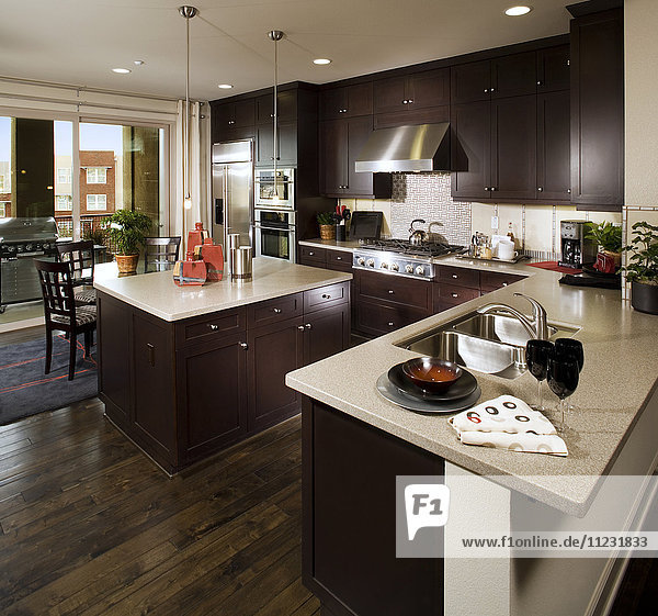 Brown wooden cabinets in contemporary kitchen